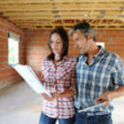 Depositphotos 13930684 cheerful couple standing inside house under construction