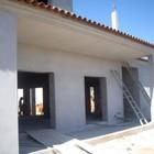 Casa toda revestida por fora com reboco projetado exterior
